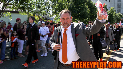 Defensive coordinator Bud Foster waves to the crowd on Beamer Way during the Hokie Walk. (Mark Umansky/TheKeyPlay.com)