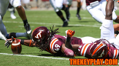 LB Tremaine Edmunds (49) reaches out to scoop a Liberty fumble in the first quarter. (Mark Umansky/TheKeyPlay.com)