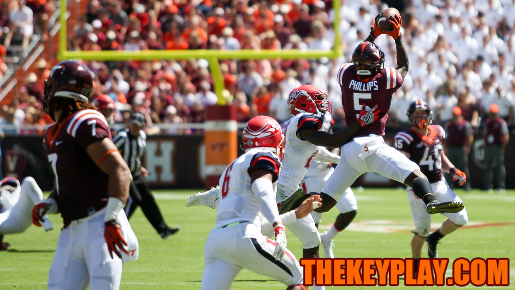 WR Cam Phillips leaps up for an acrobatic catch in the third quarter. (Mark Umansky/TheKeyPlay.com)