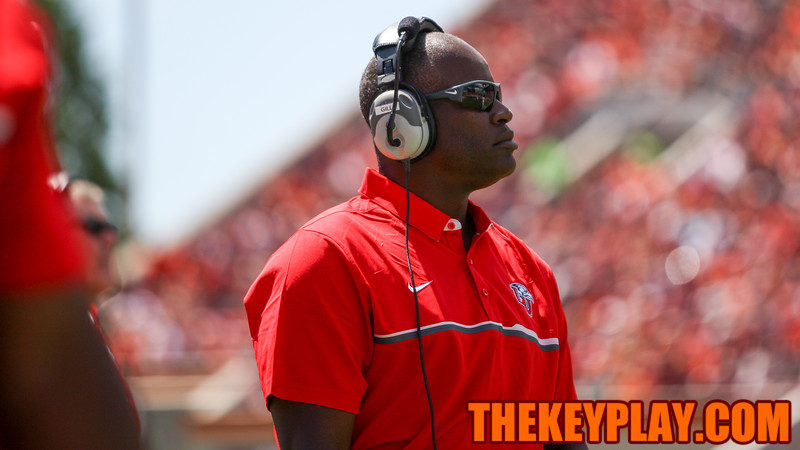 Liberty head coach Turner Gill looks at the scoreboard during a replay. (Mark Umansky/TheKeyPlay.com)