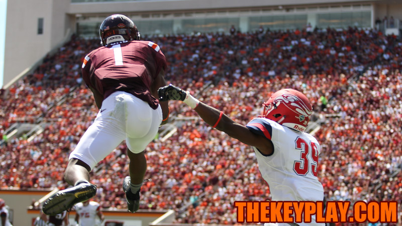 Isaiah Ford (1) leaps above Liberty's Chris Turner for a long catch. (Mark Umansky/TheKeyPlay.com)
