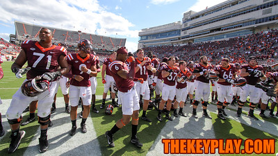 """The Hokies sing the words to """"Tech Triumph"""" alongside the Marching Virginians after handshakes. (Mark Umansky/TheKeyPlay.com)"""