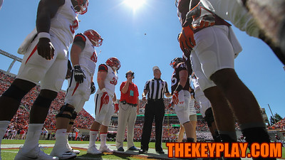 Head referee Stuart Mullins flips the coin toss before kickoff. (Mark Umansky/TheKeyPlay.com)