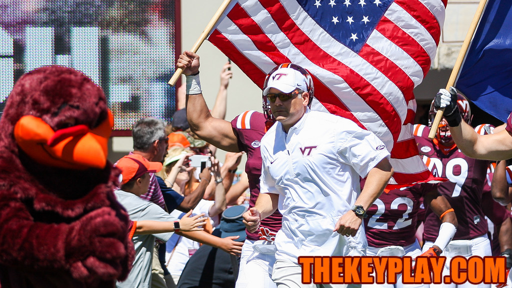 Head coach Justin Fuente runs onto the field at Lane Stadium during Enter Sandman. (Mark Umansky/TheKeyPlay.com)