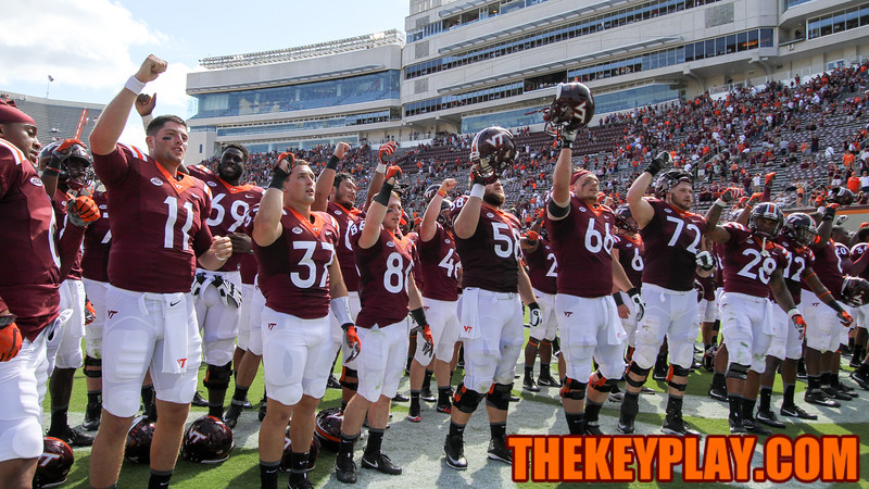 "The Hokies sing the words to ""Tech Triumph"" alongside the Marching Virginians after handshakes. Virginia Tech defeated Liberty University 36-13. (Mark Umansky/TheKeyPlay.com)"