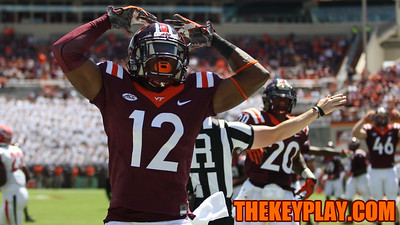 Henri Murphy pumps up the student section after another touchback on kickoff. (Mark Umansky/TheKeyPlay.com)