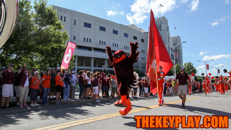 The Hokiebird jumps and runs as the start of the Hokie Walk kicks off. (Mark Umansky/TheKeyPlay.com)