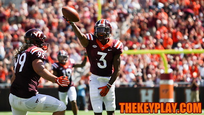 DB Greg Stroman holds the ball up after his second interception of the day. (Mark Umansky/TheKeyPlay.com)