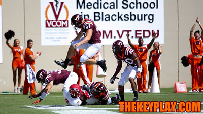 The Hokies force Liberty's Damian King to the ground in the endzone for a safety in the third quarter. (Mark Umansky/TheKeyPlay.com)