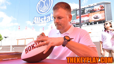 Head coach Justin Fuente signs a football for a fan. (Michael Shroyer/ TheKeyPlay.com)