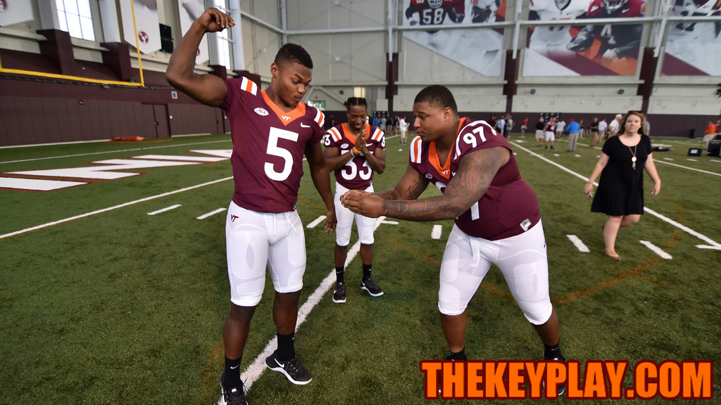 Wide receiver Cam Phillips (5) and defensive tackle Tim Settle (97) goof off for the @VT_Football selfie camera. (Michael Shroyer/ TheKeyPlay.com)