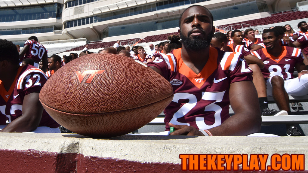 Safety Der'Woun Greene poses with a VT logo football immediately after the team photo. (Michael Shroyer/ TheKeyPlay.com)
