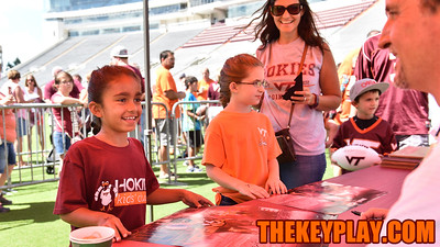 A young Hokie fan has her poster signed by defensive coordinator Bud Foster. (Michael Shroyer/ TheKeyPlay.com)