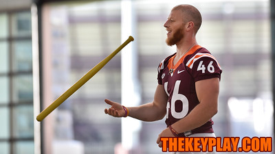 Kicker Joey Slye flips a waffle ball bat. (Michael Shroyer/ TheKeyPlay.com)