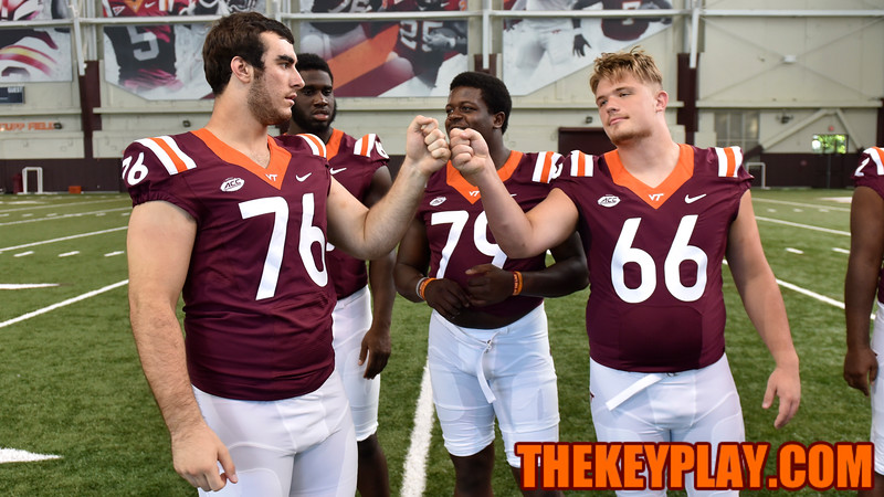 Offensive lineman Jarrett Hopple (76) and Billy Ray Mitchell (66) await their group photo. (Michael Shroyer/ TheKeyPlay.com)