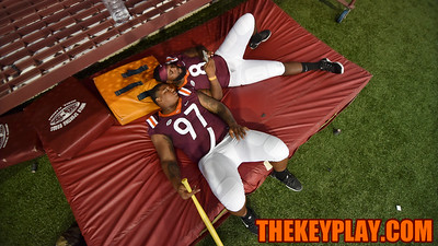 Defensive tackles Tim Settle (97) and Nigel Williams (8) relax on a giant mat. (Michael Shroyer/ TheKeyPlay.com)