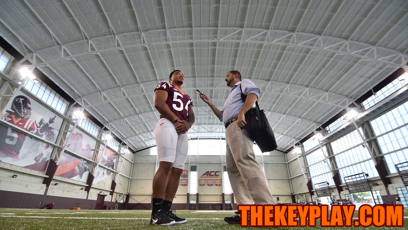 Andrew Motuapuaka speaks with the Richmond Times-Dispatch's Mike Barber. (Michael Shroyer/ TheKeyPlay.com)