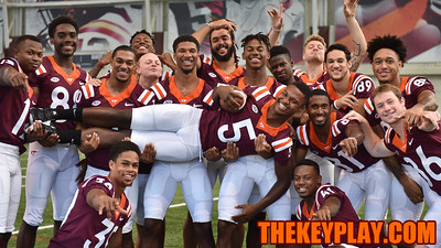 Members of the wide receiving corps lift Cam Phillips for a fun photo. (Michael Shroyer/ TheKeyPlay.com)