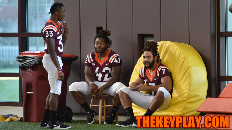 Tight end Bucky Hodges (7), running back Marshawn Williams (42), and running back Deshawn McClease (33) relax as they wait for photos and interviews. (Michael Shroyer/ TheKeyPlay.com)