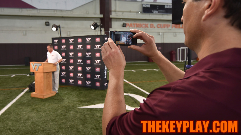 Defensive coordinator Bud Foster is recorded for social media as he speaks to assembled members of the media on Media Day. (Michael Shroyer/ TheKeyPlay.com)