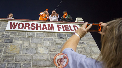 A group of Miami fans pose for a picture with the Worsham Field sign inside Lane Stadium. (Mark Umansky/TheKeyPlay.com)