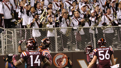 The Hokies special teams unit pumps up the crowd in the endzone after kicking a touchback. (Mark Umansky/TheKeyPlay.com)