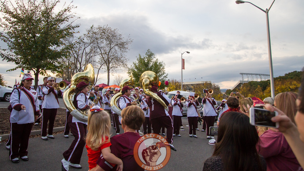 Members of the Marching Virginians perform for tailgaters before the game in exchange for donations of canned goods for charity. (Mark Umansky/TheKeyPlay.com)