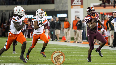 RB Travon McMillian breaks free for a long run. (Mark Umansky/TheKeyPlay.com)
