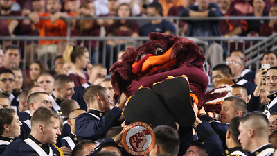 The Hokiebird gets passed up the Corps of Cadets section in the South Endzone. (Mark Umansky/TheKeyPlay.com)