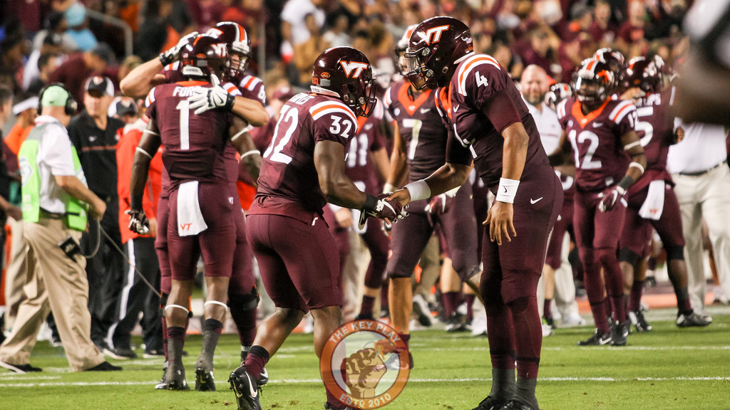FB Steven Peoples (32) and QB Jerod Evans (4) shake hands on their way back to the sideline after the touchdown. (Mark Umansky/TheKeyPlay.com)