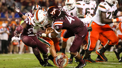 Miami QB Brad Kaaya is sacked again by Tremaine Edmunds (49). (Mark Umansky/TheKeyPlay.com)
