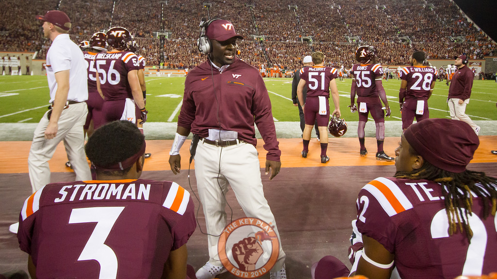 Virginia Tech cornerbacks coach Brian Mitchell speaks to his players while the offense is on the field. (Mark Umansky/TheKeyPlay.com)