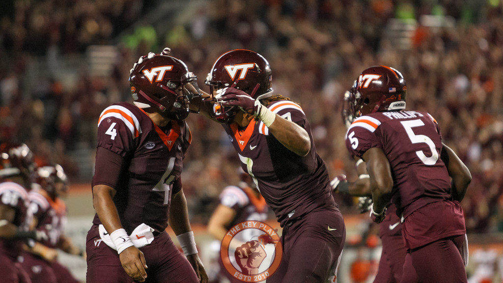 Jerod Evans (4) and Bucky Hodges (7) celebrate after the touchdown throw and catch. (Mark Umansky/TheKeyPlay.com)