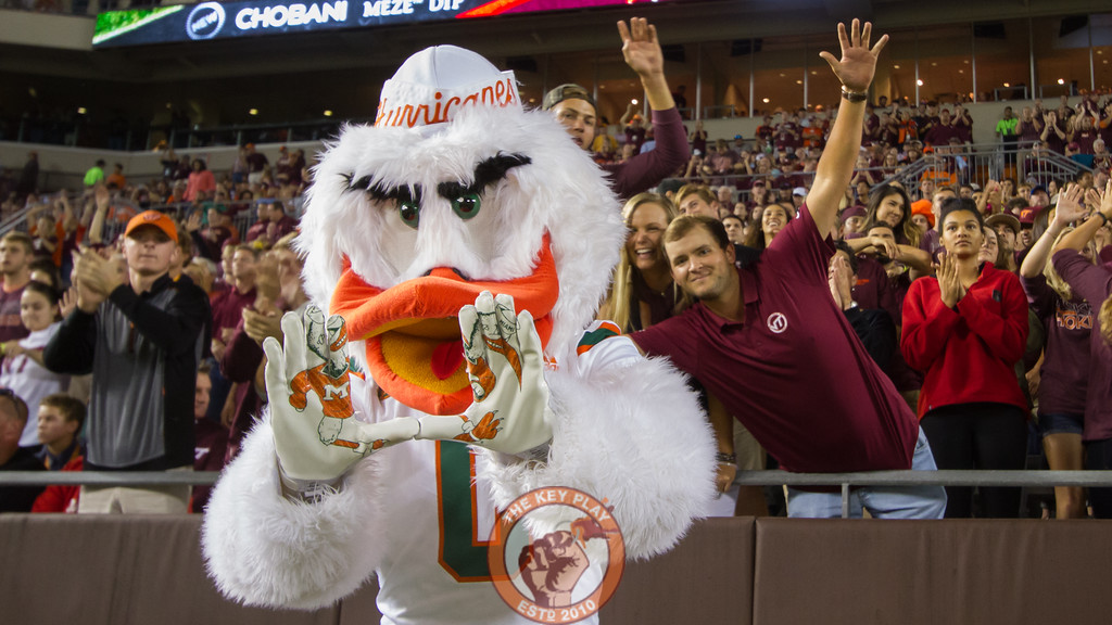 Miami mascot Sebastian the Ibis poses in front of a group of Hokies fans. (Mark Umansky/TheKeyPlay.com)