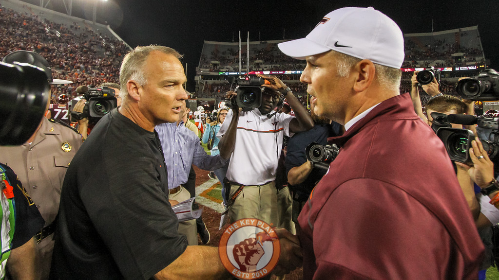 Miami head coach Mark Richt (left) shakes hands with Virginia Tech head coach Justin Fuente (right) after the final whistle. (Mark Umansky/TheKeyPlay.com)