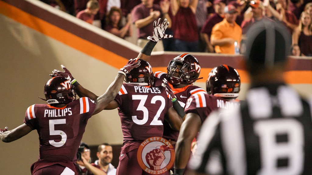 The Hokies celebrate after another touchdown in the third quarter. (Mark Umansky/TheKeyPlay.com)