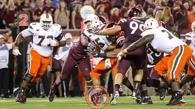 The Hokies defensive line collapses around Miami QB Brad Kaaya for the a sack. (Mark Umansky/TheKeyPlay.com)