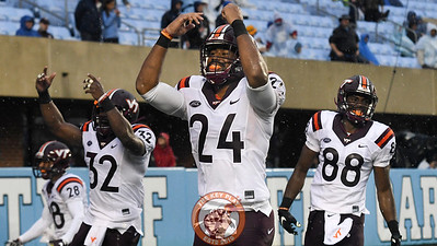 Virginia Tech linebacker Anthony Shegog (24), full back Steven Peoples (32), and wide receiver Divine Deablo (88) celebrate their kickoff team's touchback. (Michael Shroyer/ TheKeyPlay.com)