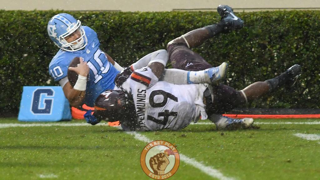 Virginia Tech linebacker Tremaine Edmunds (49) sacks North Carolina quarterback Mitch Trubisky (10) close to the goal line. (Michael Shroyer/ TheKeyPlay.com)