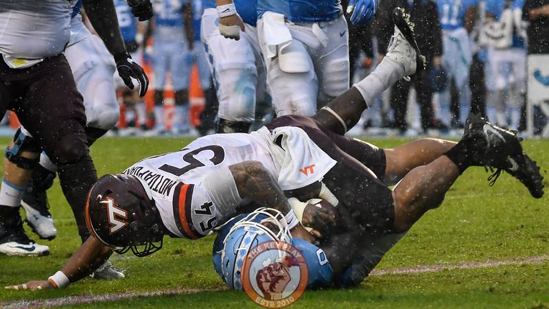 Virginia Tech linebacker Andrew Motuapuaka (54) tackles North Carolina running back T.J. Logan (8) into the ground. (Michael Shroyer/ TheKeyPlay.com)