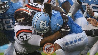 Virginia Tech defensive tackle Tim Settle (97) wraps up North Carolina running back Khris Francis (1). (Michael Shroyer/ TheKeyPlay.com)