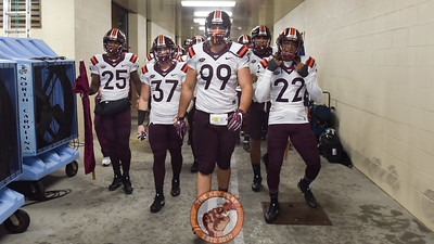 Virginia Tech defensive lineman Vinny Mihota (99), leads wide receiver Cam Phillips (25), linebacker Johnathan Galante (37), and rover Terrell Edmunds (22) down the tunnel. (Michael Shroyer/ TheKeyPlay.com)