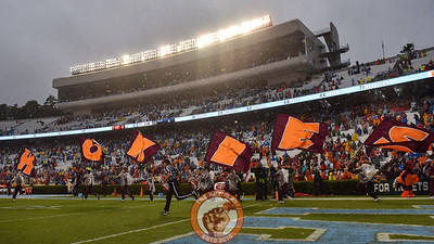 The Virginia Tech Hokies cheerleaders lead the team onto the field. (Michael Shroyer/ TheKeyPlay.com)
