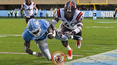North Carolina running back T.J. Logan (8) is pushed out of bounds by Virginia Tech linebacker Tremaine Edmunds (49). (Michael Shroyer/ TheKeyPlay.com)