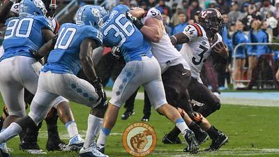 Virginia Tech running back Travon McMillian (34) follows the block around the outside created by offensive lineman Wyatt Teller (57). (Michael Shroyer/ TheKeyPlay.com)