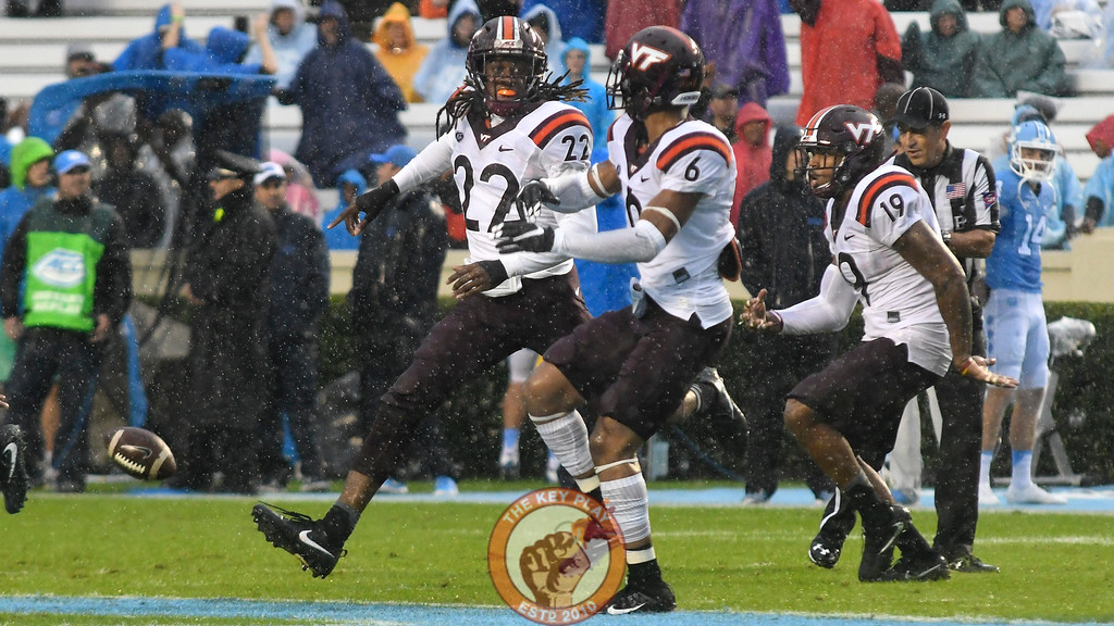 Virginia Tech rover Terrell Edmunds (22), safety Mook Reynolds (6), and defensive back Chuck Clark (19) celebrate an early turnover. (Michael Shroyer/ TheKeyPlay.com)