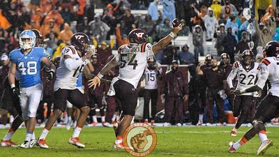 Virginia Tech linebacker Andrew Motuapuaka (54) celebrates his interception. (Michael Shroyer/ TheKeyPlay.com)