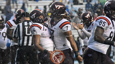 Virginia Tech quarterback Jerod Evans (4) celebrates his touchdown run with tight end Bucky Hodges (7). (Michael Shroyer/ TheKeyPlay.com)