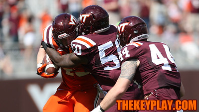 FB Sam Rogers tries to break a tackle by Jamieon Moss (50). (Mark Umansky/TheKeyPlay.com)