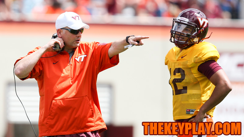 Head coach Justin Fuente points as he speaks with QB Josh Jackson. (Mark Umansky/TheKeyPlay.com)